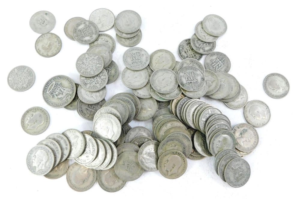 A quantity of George V and George VI sixpences etc., to include some silver.