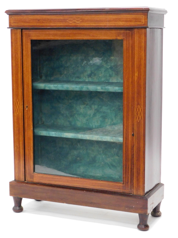 An Edwardian mahogany and boxwood strung display cabinet, the top with a moulded edge above a glazed