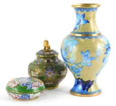 Three items of oriental cloisonne, to include a jar and cover with lion mount to the lid, 13cm high,
