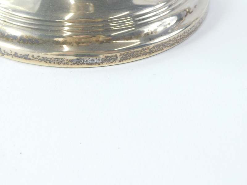 A pair of Elizabeth II silver candlesticks, each with reeded decoration, with a waisted column and - Image 2 of 2