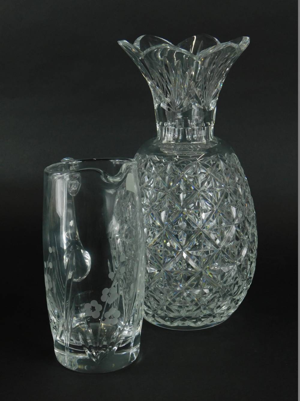 A cut glass pineapple shaped vase, 31cm high, and a Royal Doulton hand cut crystal jug, boxed. (2)