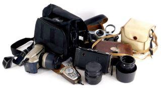 A quantity of cameras, to include a Minolta AL-F, a Minolta 5000 with Tamron lens, etc.