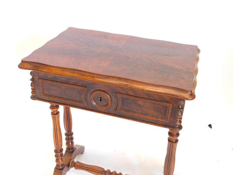 A 19thC French walnut work table, the rectangular quarter veneered top with a moulded edge enclosing - Image 2 of 2