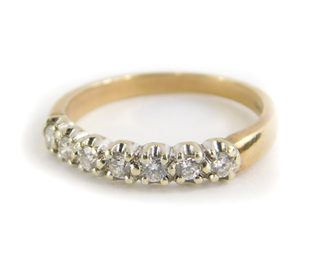 A 9ct gold half hoop eternity ring, set with seven round brilliant cut diamonds, in claw white