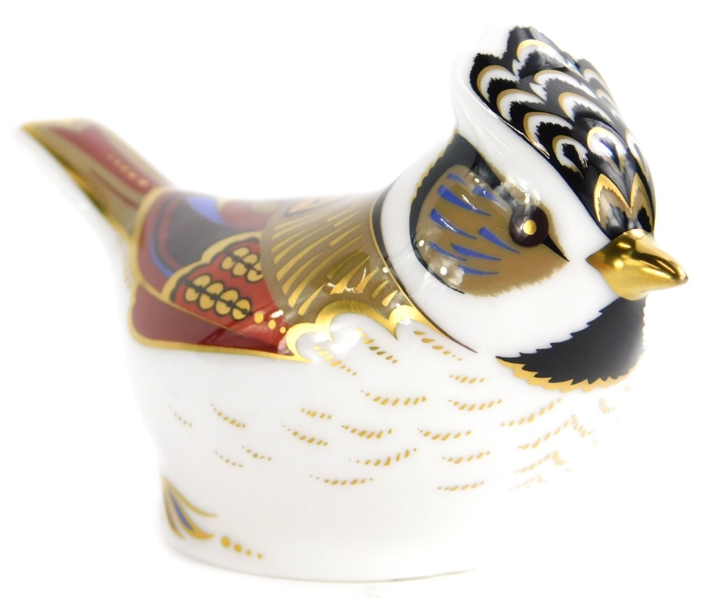 A Royal Crown Derby porcelain paperweight, modelled in the form of a bird, faceted anniversary