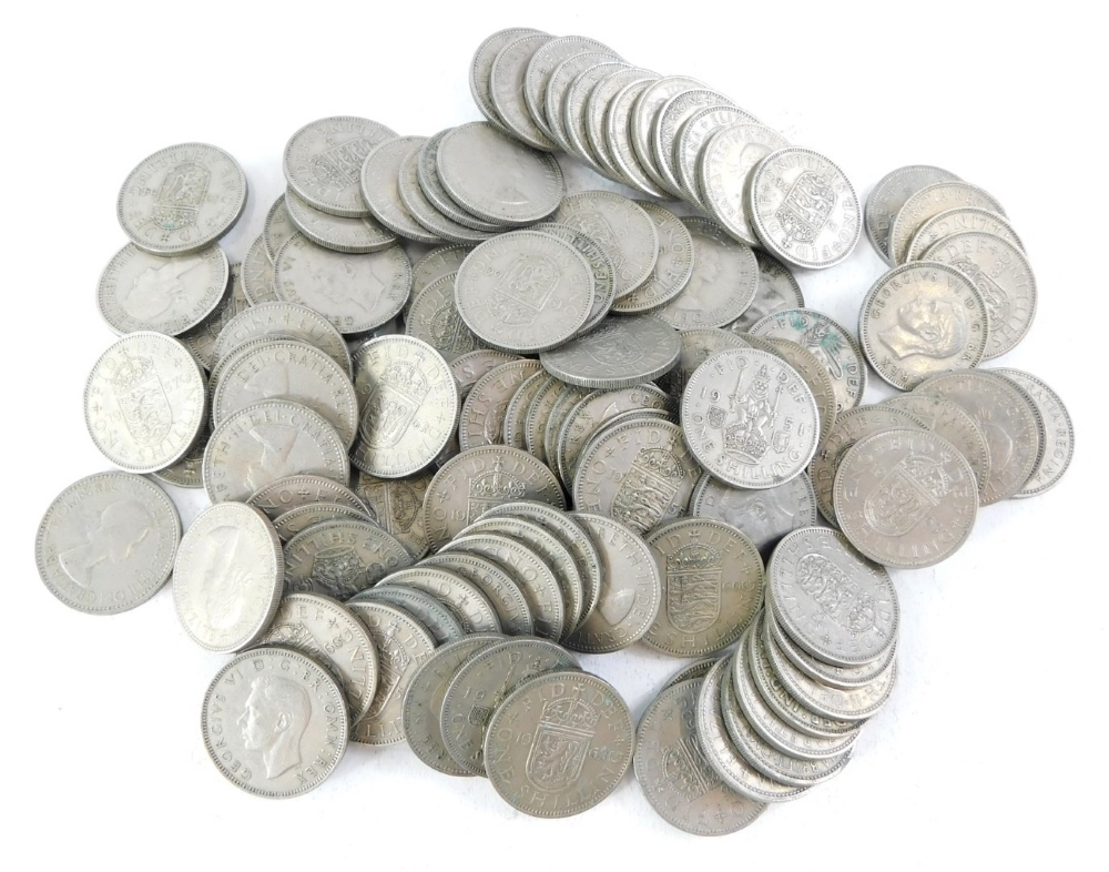 A large quantity of George VI and Elizabeth II one shilling coins.