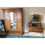 A late Victorian mahogany wardrobe, and dressing chest, with marquetry and satinwood cross