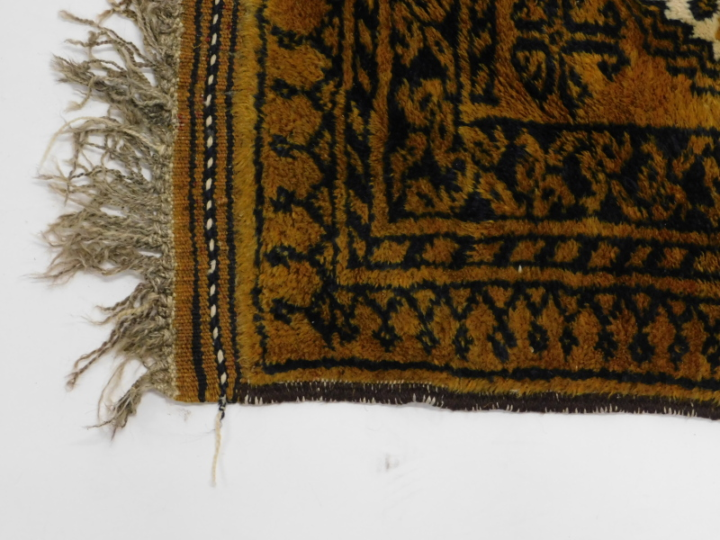 An Afghan rug, with a design of two medallions, on a brown ground, 60cm x 94cm. - Image 2 of 3