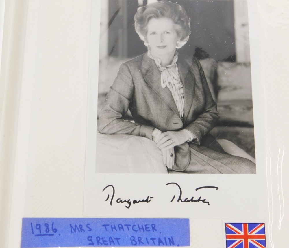 An album containing political photographs, to include some bearing the signatures of Margaret