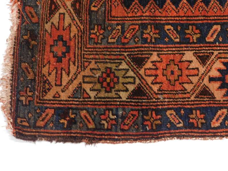 A Persian rug, with a design of three medallions, on a blue ground 116cm x 166cm. - Image 2 of 3