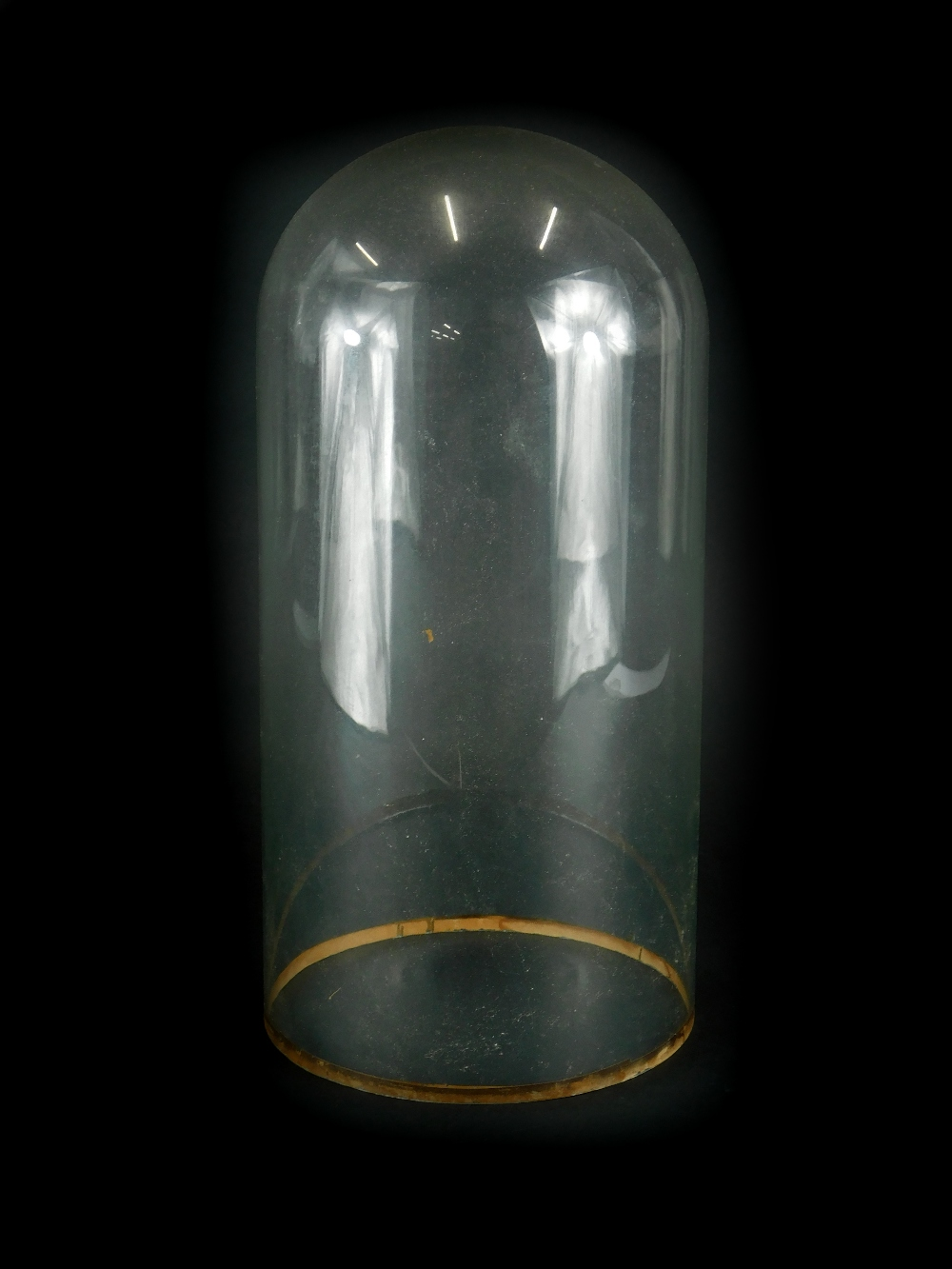 A glass dome, lacking stand, 35cm high.