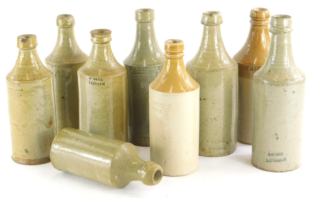 A collection of stoneware, mainly beer bottles, stamps to include C.Bell, Lincoln, Harrison,