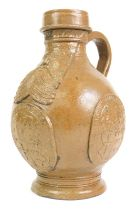 A stoneware Bellarmine jug, decorated with a bearded mask and with three continental crests,