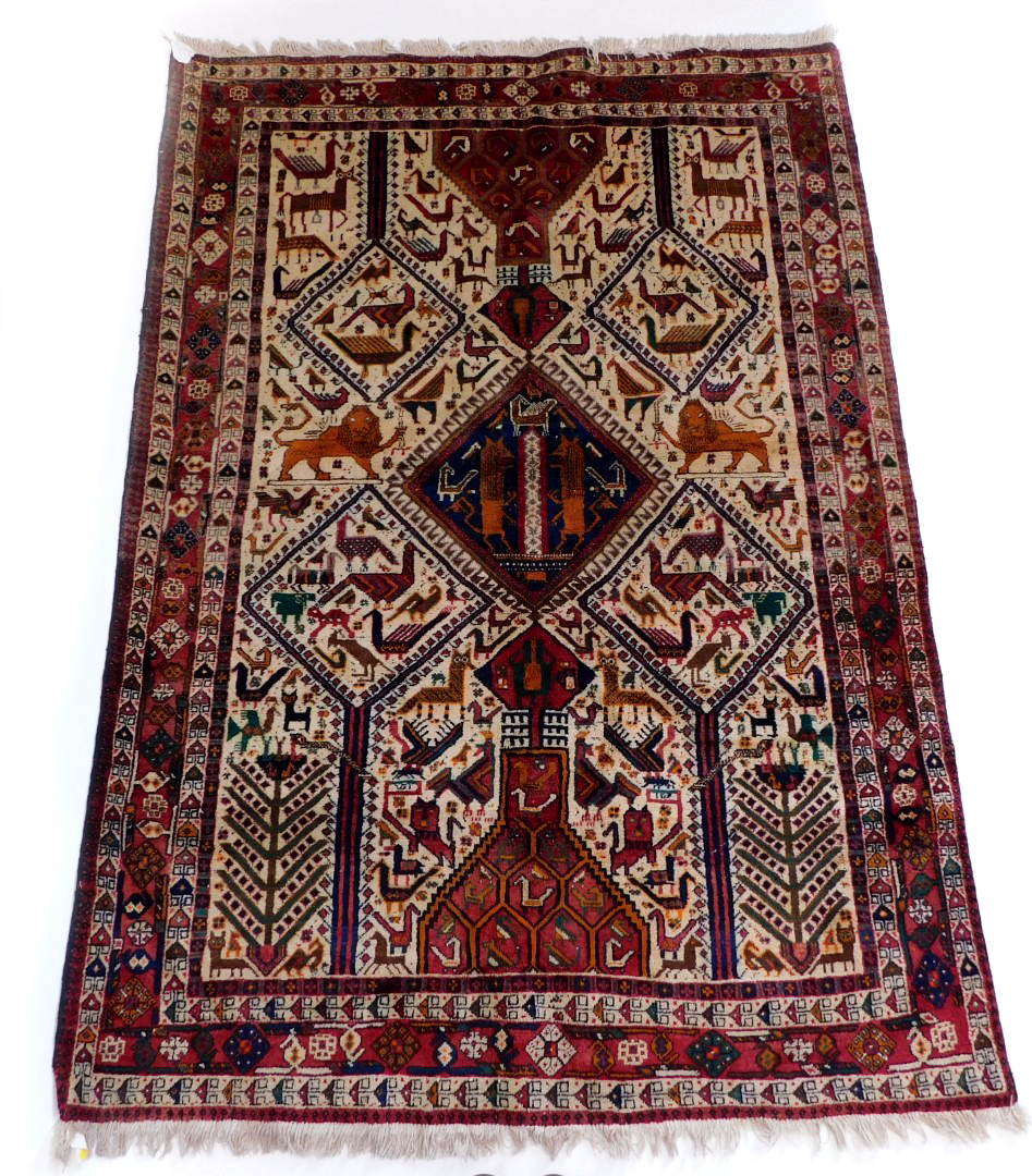 An Indian rug, with an all over design of animals, to include lions, cat like animals, birds,