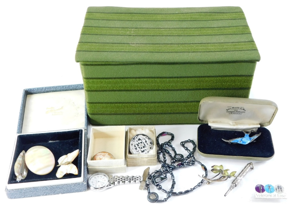 A quantity of costume jewellery, to include mother of pearl brooches, a nurses watch brooch, an
