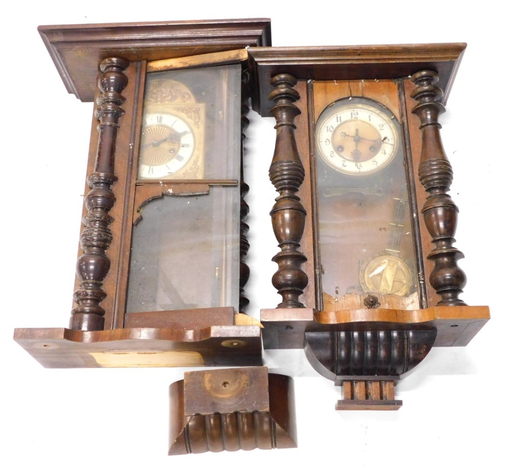 Two late 19th/early 20thC walnut Vienna type wall clocks, each with enamel decoration to the dial,
