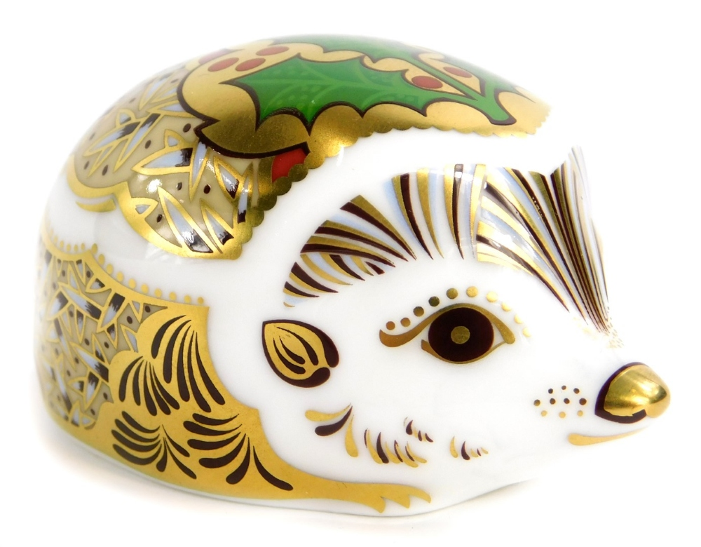 A Royal Crown Derby porcelain paperweight, modelled in the form of a Hedgehog Holly.