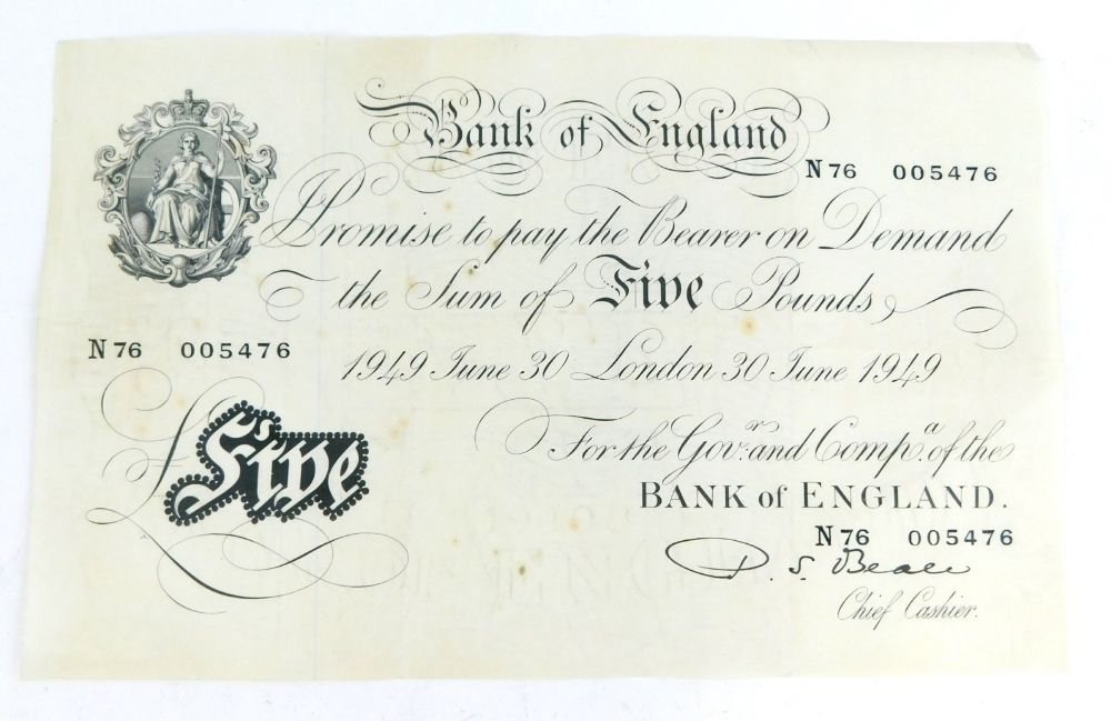 A Bank of England white £5 note issued 1949 June 30th, Chief Cashier Beale.