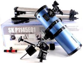 A Sky Watcher Reflector telescope, number SKP1145EQ1, in pale purple with tripod, original box,