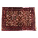A Persian Kayam type rug, with an all over design, on a red ground, 105cm x 145cm.