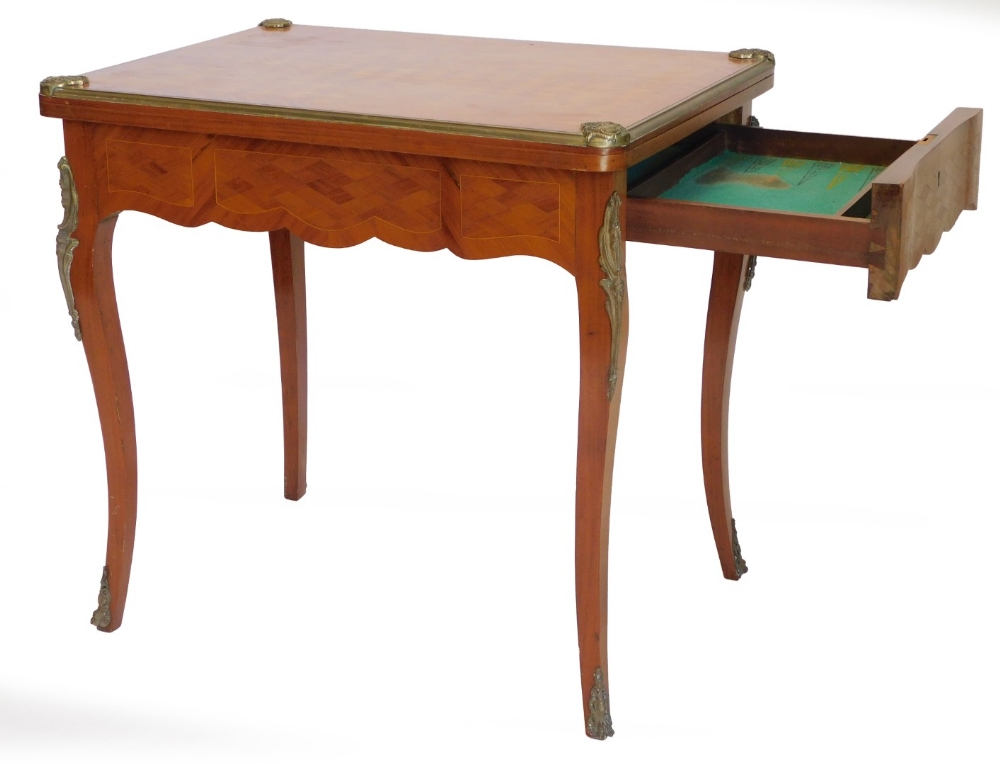 A French mahogany and boxwood strung card table, with gilt metal mounts, the rectangular top with