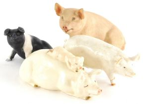 Two Beswick pigs, to include a figure of a pig with a piglet, another Champion Wall Queen, a Country