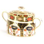 A Royal Crown Derby porcelain two handled sugar bowl and cover, decorated with the 1128 Imari