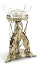 An Elkington and Co silver plated stand, in French Empire style, with a central three handled