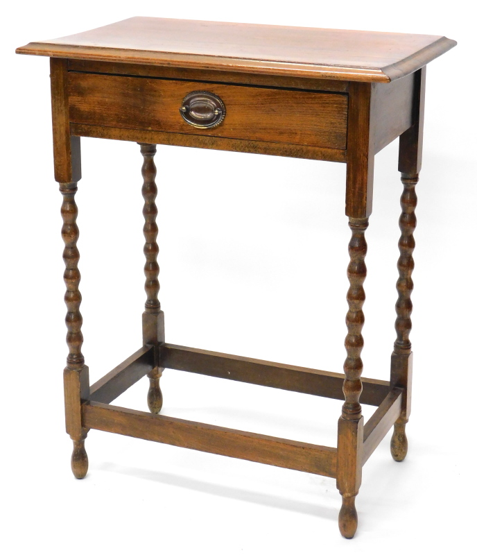 An oak side table, the top with a moulded edge, above a frieze drawer, on bobbin turned legs, 61cm
