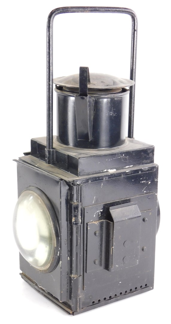 A railway type black toleware lantern, stamped BRE with clear glass lenses, 46cm high.