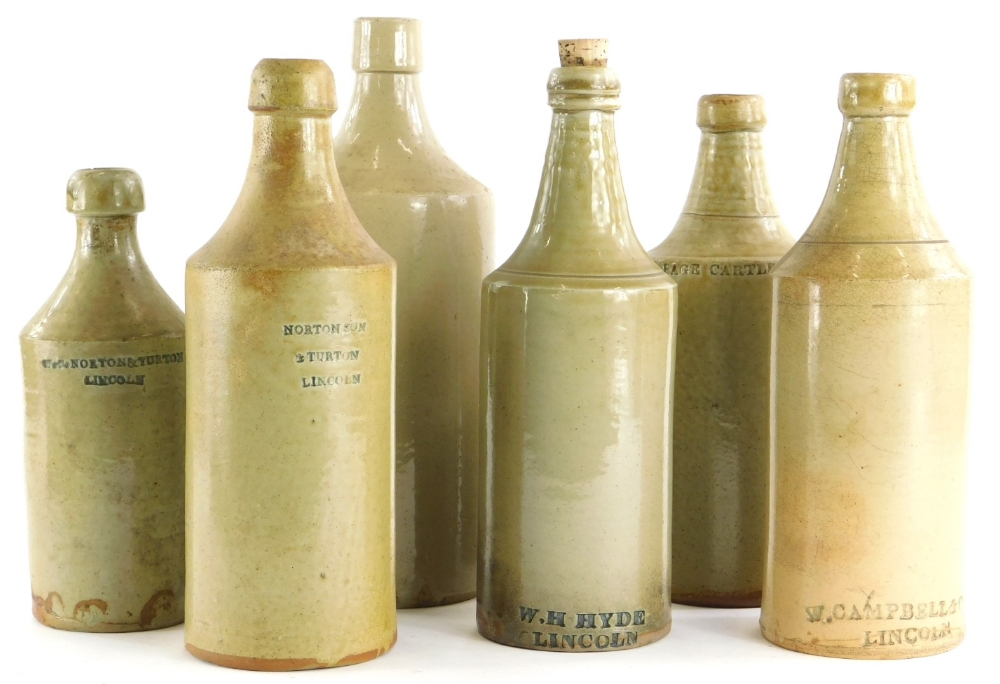 A collection of Lincoln stoneware bottles, to include W.Cottingham Chemist, another stamped W.H.