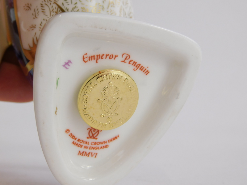 A Royal Crown Derby porcelain paperweight, modelled in the form of an Emperor penguin, gold button - Image 2 of 2