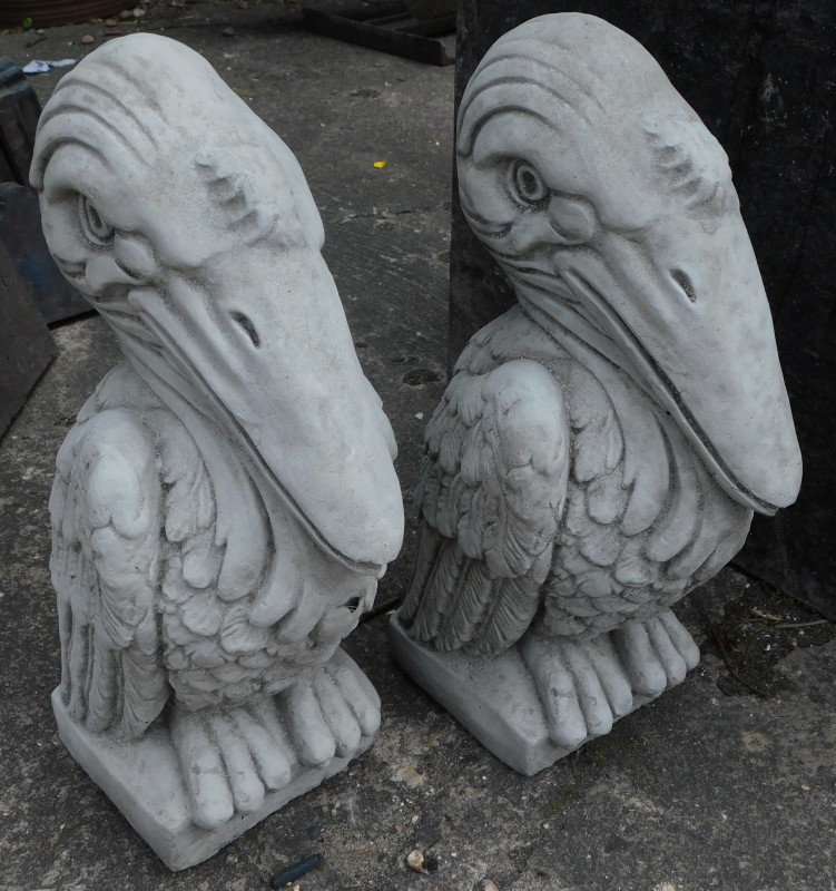 A pair of garden ornaments, each modelled in the form of a Wally bird, 40cm high.