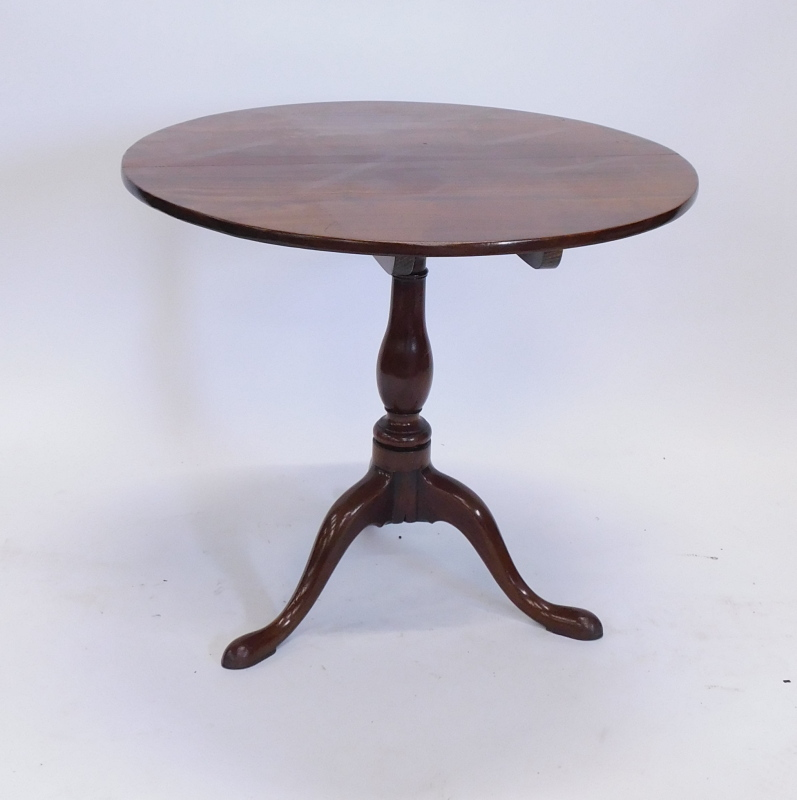 A mahogany tilt top occasional table, with a circular top on a turned column and tripod base, - Image 2 of 2