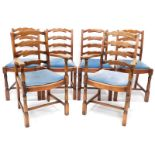 A set of six oak ladder back chairs, each with a drop in seat, on part turned supports.