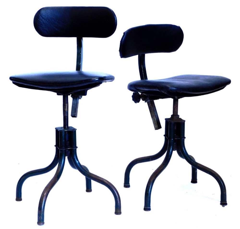 A pair of mid 20thC green painted industrial machinist or engineers chairs or stools, (Tan-sad) each
