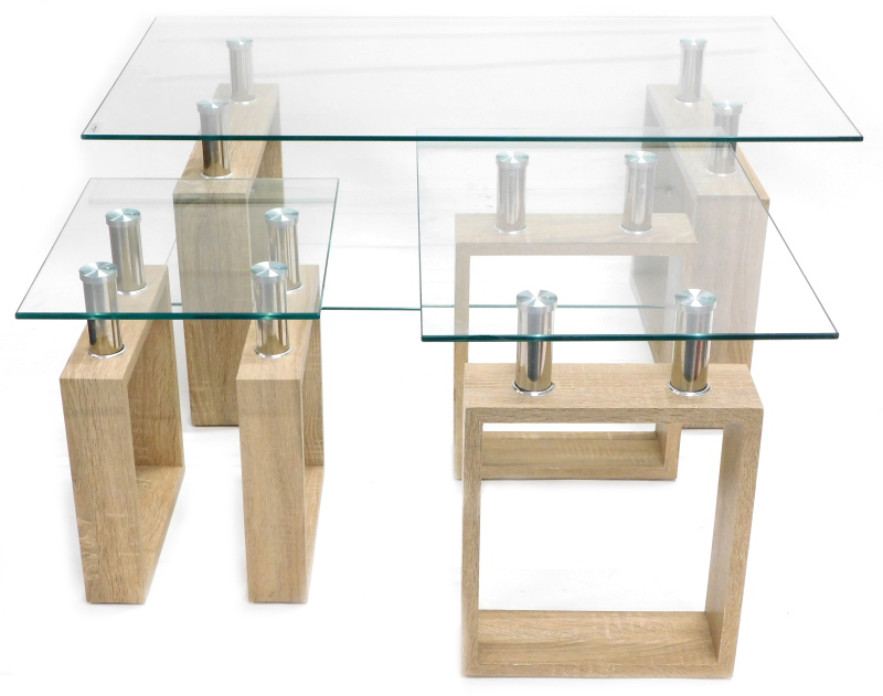 A modern limed wood effect coffee table, with glass top and two similar occasional tables, 100cm