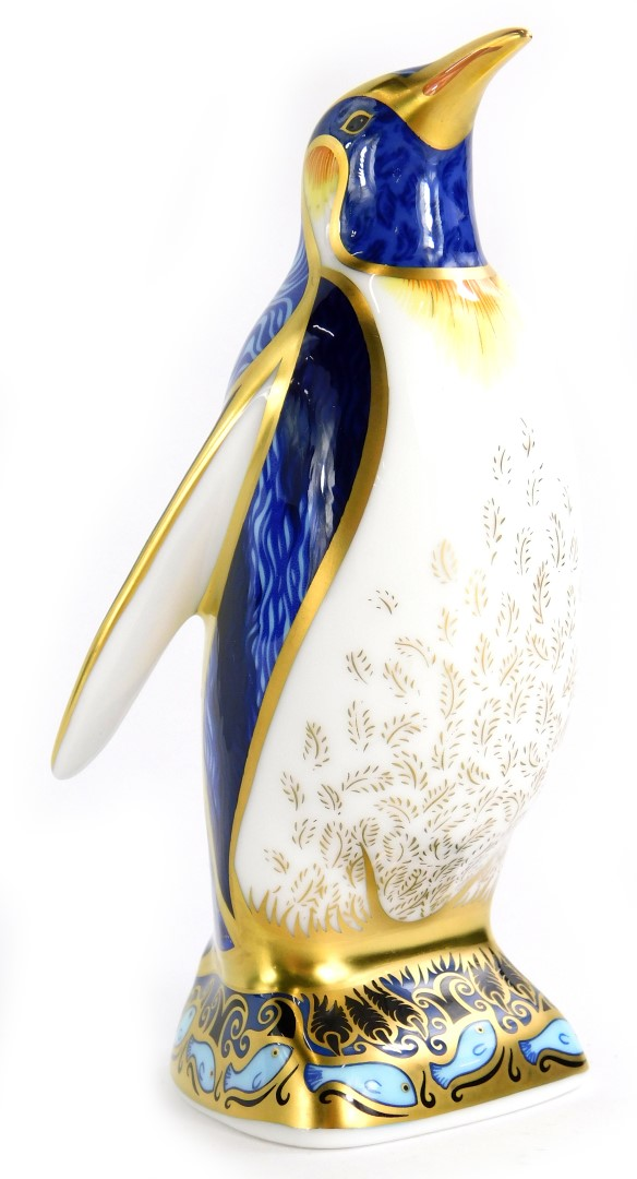 A Royal Crown Derby porcelain paperweight, modelled in the form of an Emperor penguin, gold button