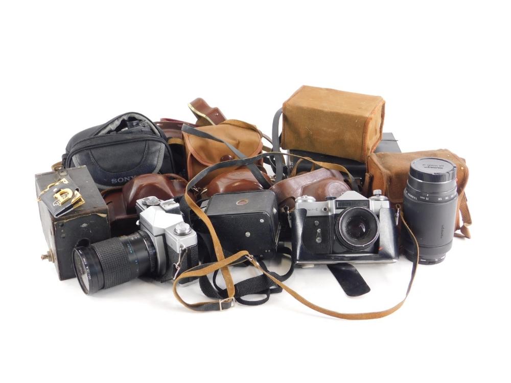 A collection of cameras, to include a Sony DVD Cine camera, a Tamron Auto focus lens, Zenit-e