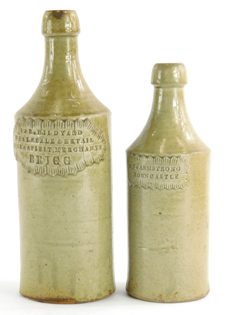 Two stoneware porter bottles, stamped R.C.Armstrong, Horncastle, and H and R Hildyard, Wholesale and