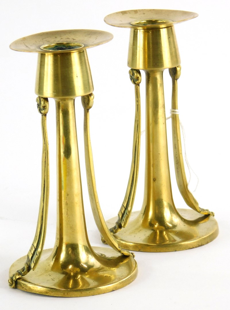 A pair of late 19thC brass secessionist design candlesticks, of tapering form, 14cm high.