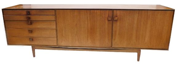 A 1960's teak sideboard, possibly Kefod Larsson for G-plan, with five graduated drawers, and two