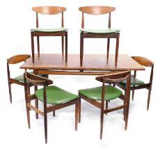 A G-plan Danish design teak extending dining table, with a rectangular top, with a plain frieze on