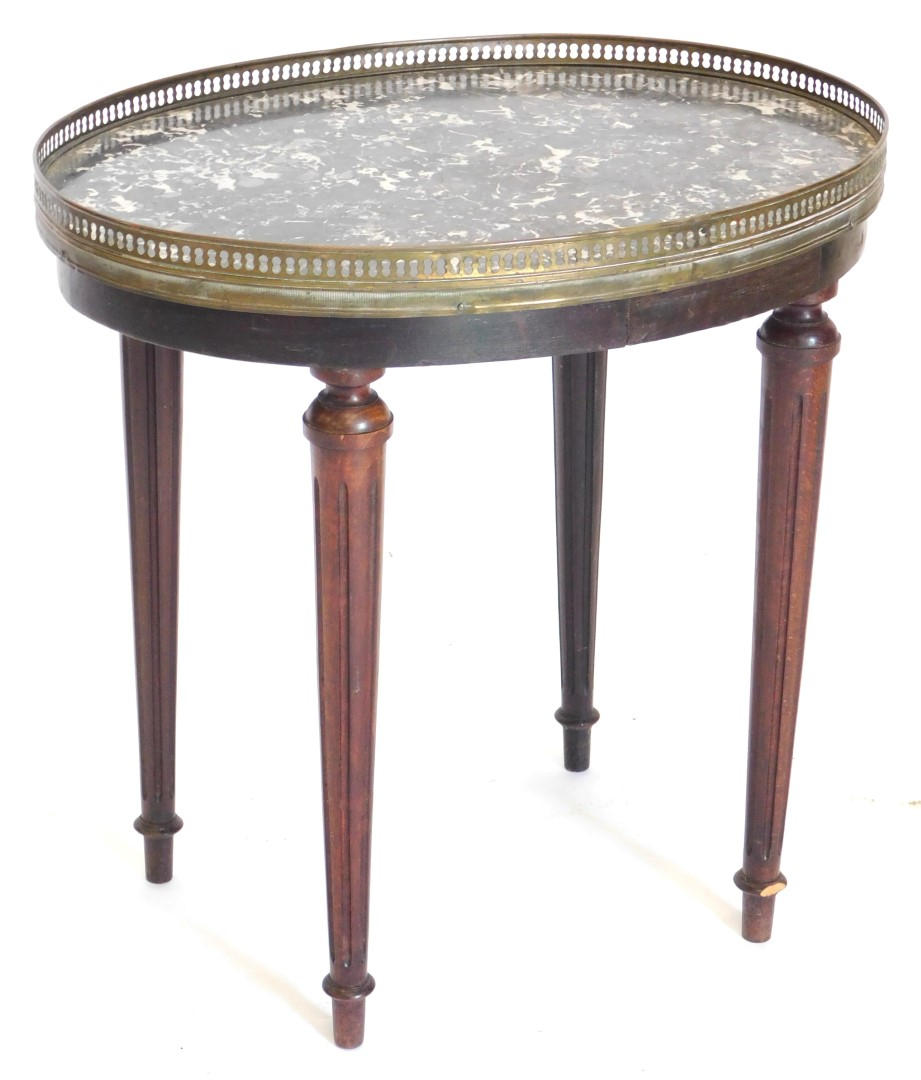 A French stained beech occasional table, the oval top with a grey marble insert and a pierced