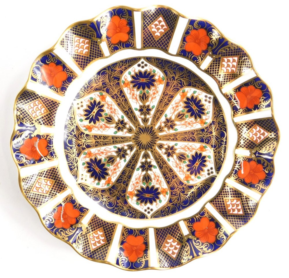 A Royal Crown Derby porcelain plate, with a petalated border, decorated with the 1128 Imari pattern,
