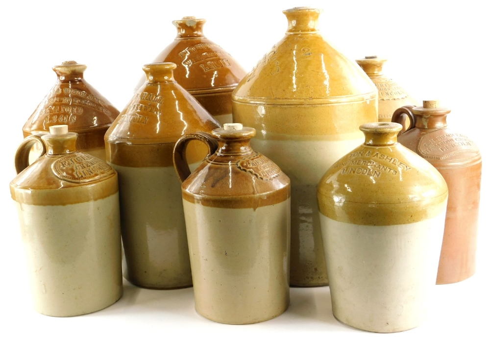 A collection of Lincoln stoneware flagons, names to include Thornton, William Cass, Robert Drury,
