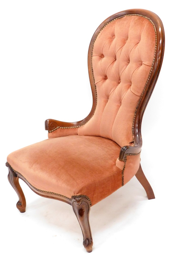 A stained beech nursing chair in Victorian style, with a button padded back, padded seat on cabriole