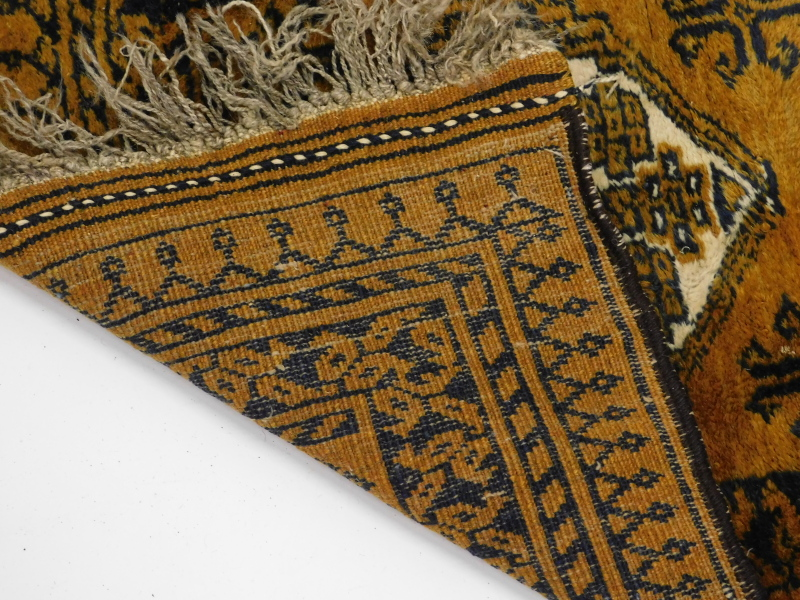 An Afghan rug, with a design of two medallions, on a brown ground, 60cm x 94cm. - Image 3 of 3