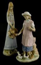 A Lladro porcelain figure of a young girl feeding doves, (AF), 28cm high, and a Spanish porcelain