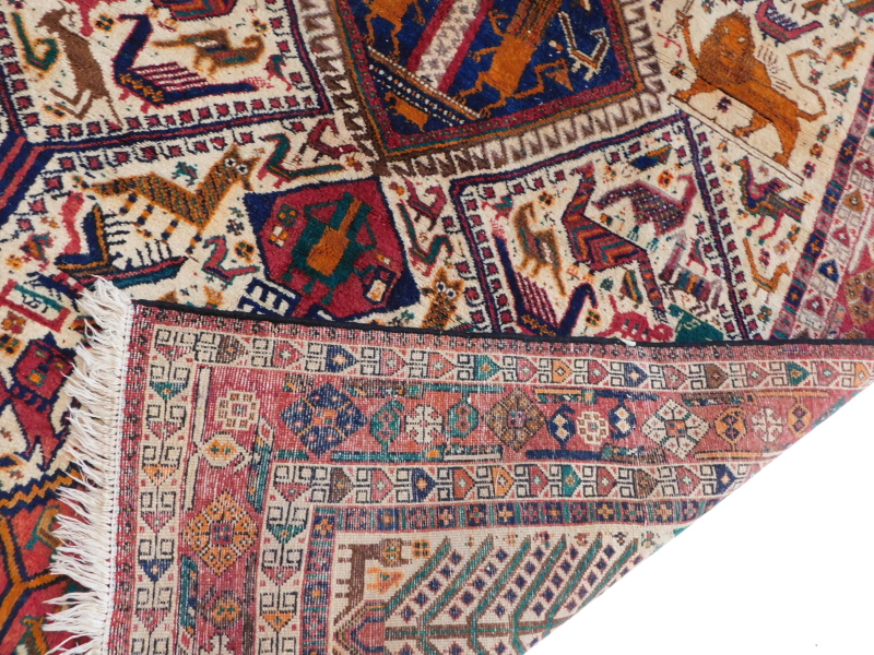 An Indian rug, with an all over design of animals, to include lions, cat like animals, birds, - Image 3 of 3